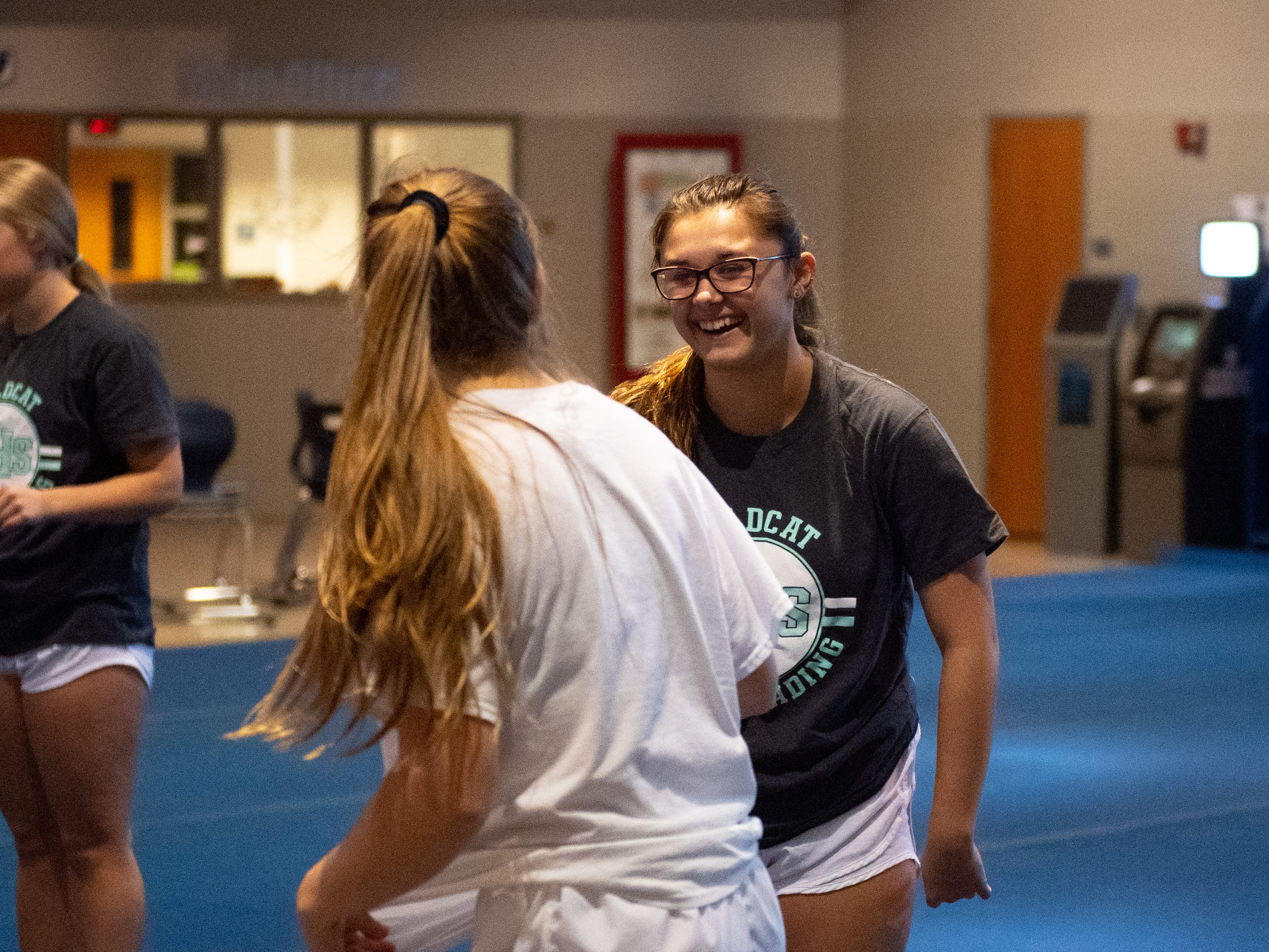 Abrianna Gentile jokes with a teammate during Dallastown's competitive spirit practice, November 14, 2018.