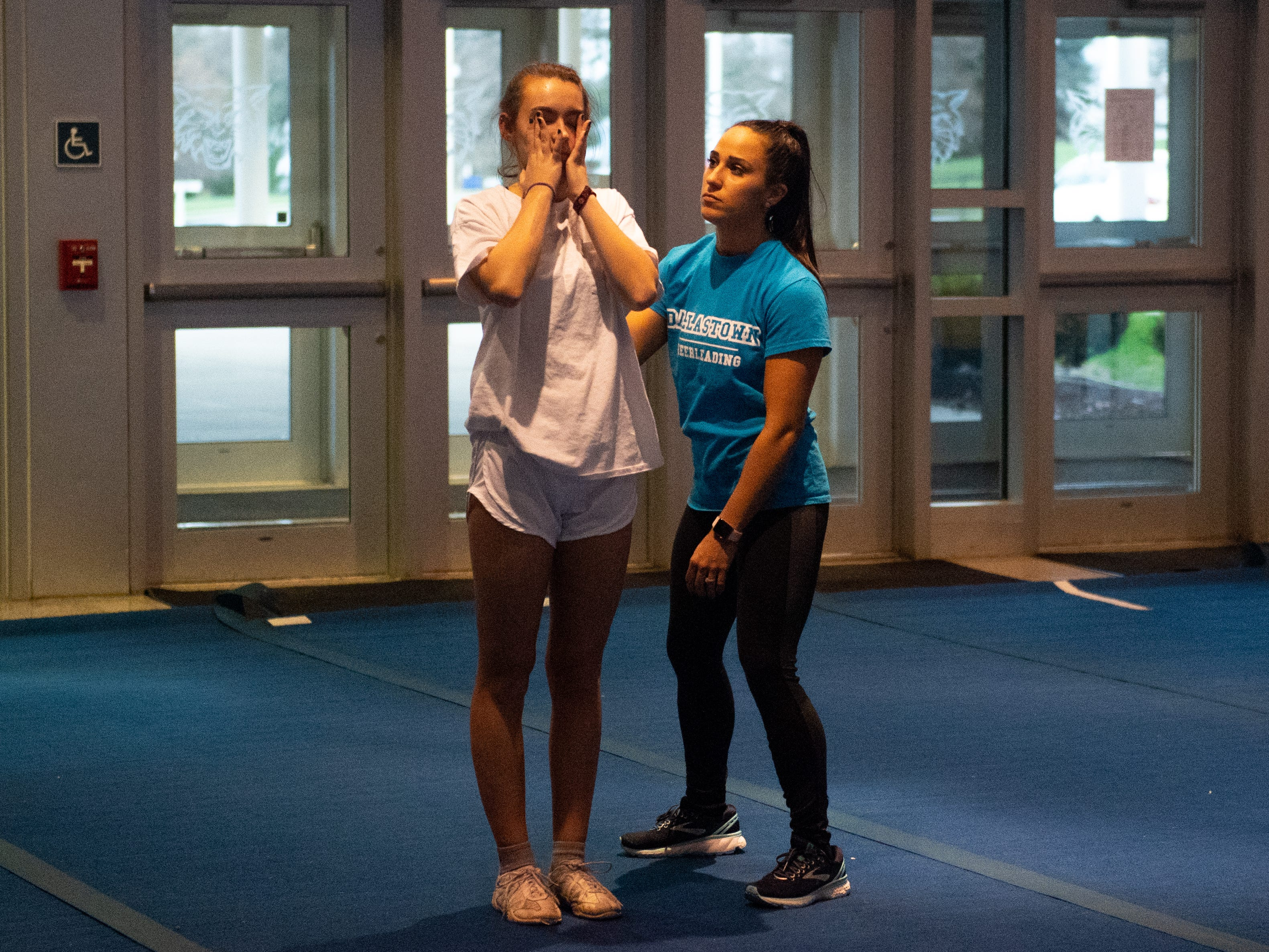 Assistant Coach Toni Sprenkle (right) helps Savannah Mowen (left) do a backflip during Dallastown's competitive spirit practice, November 14, 2018.