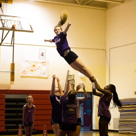 Abby Reiber soars through the air during Dover's competitive spirit practice, November 14, 2018.