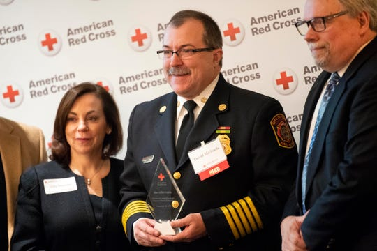 York Fire Chief David Michaels, center, received the 'Community Leadership' award in November from the local Red Cross.