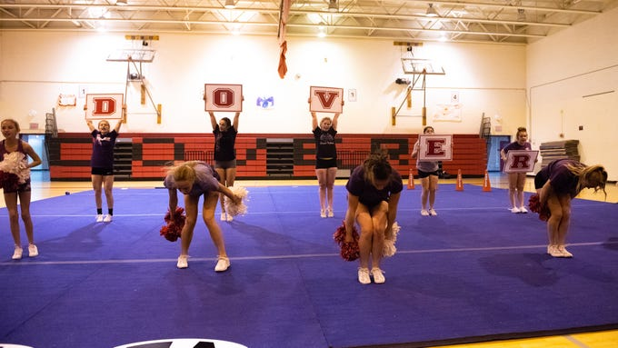 Dover's competitive spirit team runs through their routine during practice, November 14, 2018.