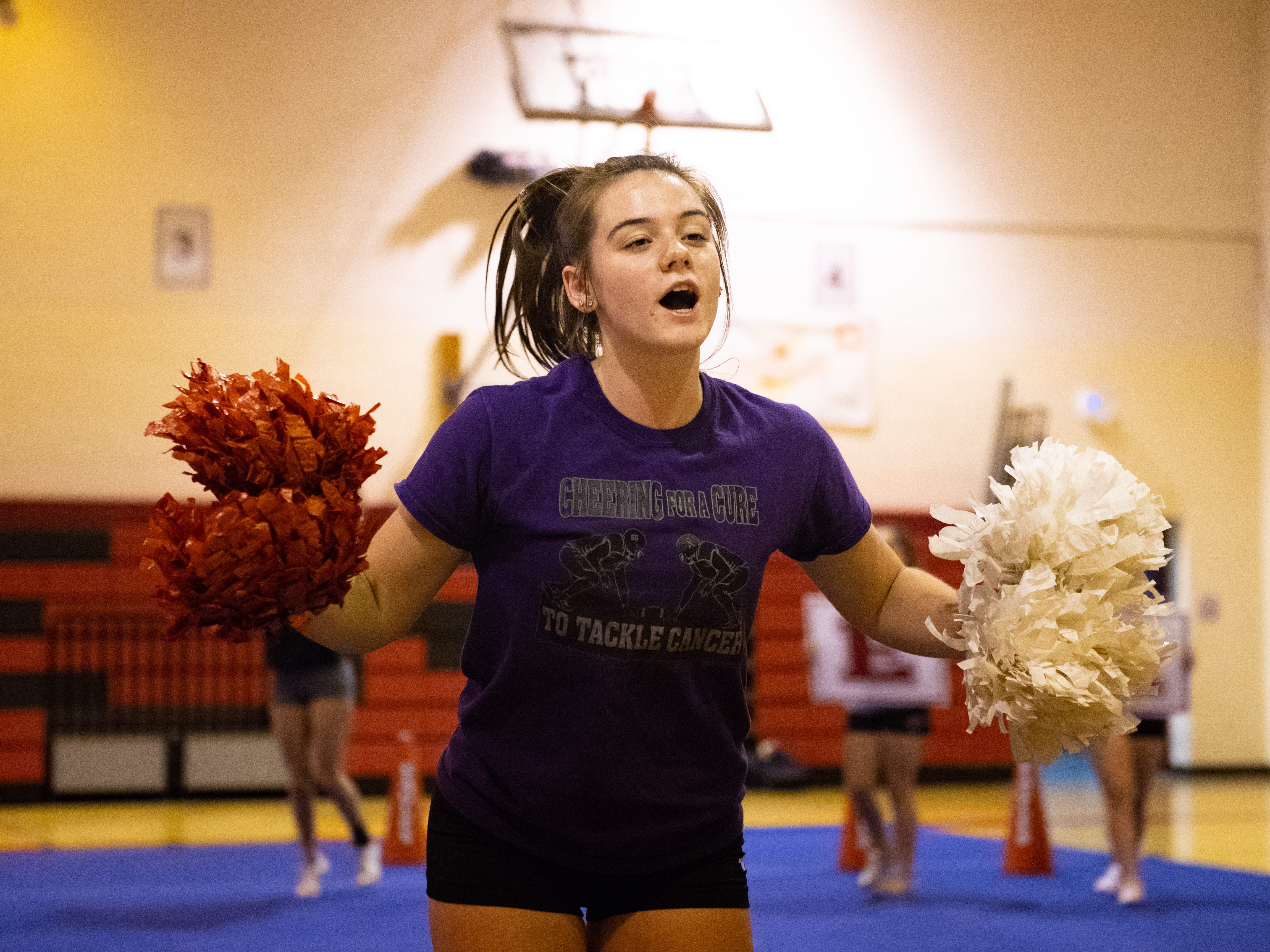 Alexis Lippert cheers during Dover's competitive spirit practice, November 14, 2018.