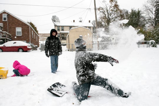 Peyton Keener, 11, throws snow back toward his friend while enjoying the season's first snowfall, Thursday, Nov. 15, 2018. Central Pa. saw its first snowfall of the season, with an estimated 4 to 8 inches accumulating.
