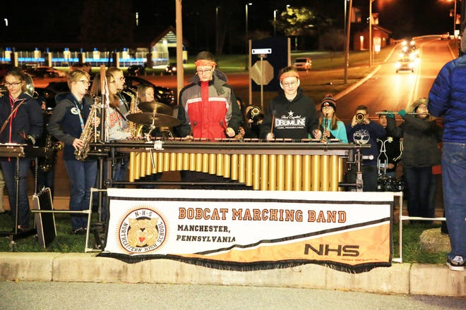 Students from the Northeastern High School marching band performing outside of the TOTO concert on Saturday, Nov. 10. The marching received a surprise from TOTO founding member Steve Porcaro and musician Warren Ham, as the two stepped out and watched them perform a few songs.