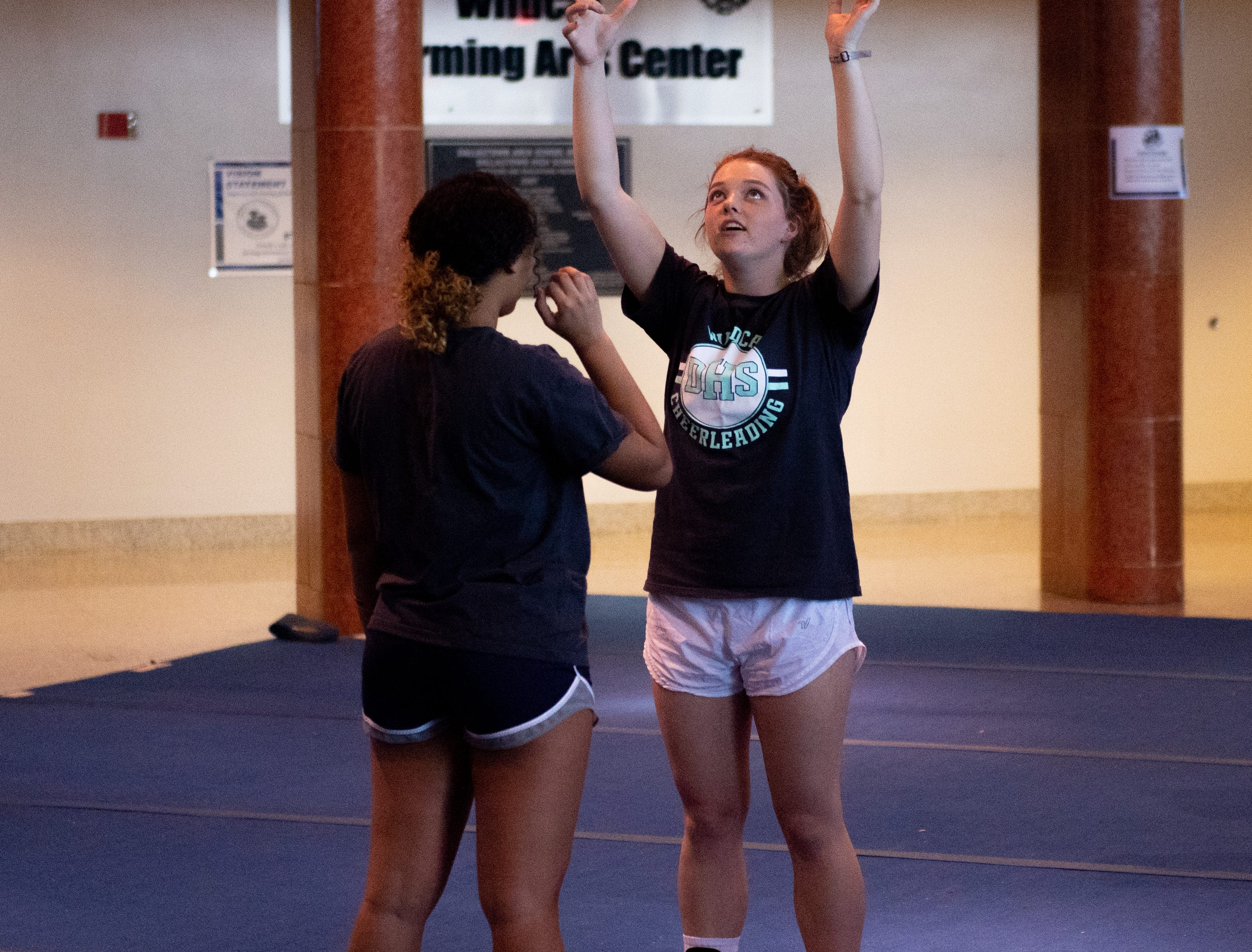 Maddie Hermin reviews how she holds up teammates during Dallastown's competitive spirit practice, November 14, 2018.