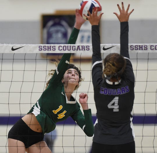 Spanish Springs' Alysa Micone attempts a block on a shot by Bishop Manogue's Allison Gunderson in the regional volleyball semifinals at Spanish Springs High School on Nov. 1.