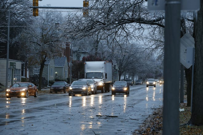 Drivers carefully make their way down North A Street in Richmond after an overnight ice storm on Thursday, Nov. 15, 2018.