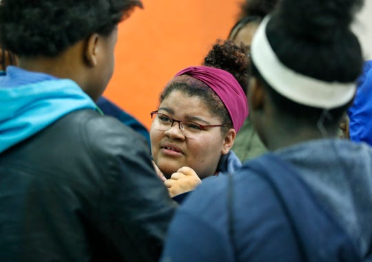 Jasmine' Ania Bush talks to other eighth graders in English class at Nathaniel Rochester Community School.