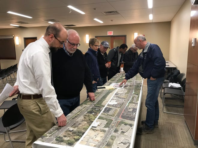 Jonathan Walczak, a senior project engineer at Barton & Loguidice, at left, speaks with Webster residents and business owners about the changes coming to certain sections of Ridge Road as part of the Multi-Modal Corridor Project.