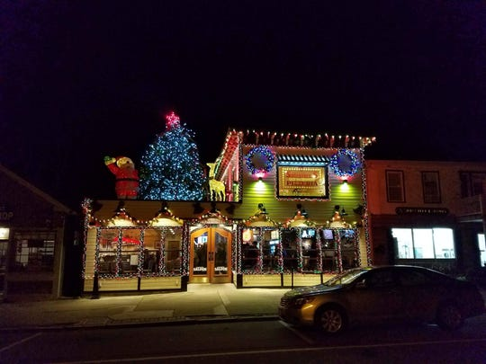 Salvatore's Saloon, at 11 Main St. in Scottsville, decorates for Christmas with a real tree on the roof and more than 12,000 lights.