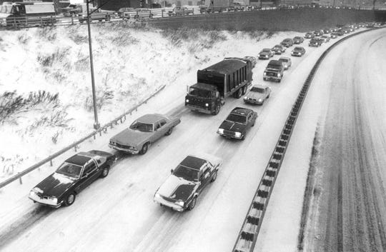 In this photo from November, 1980, traffic on I-490 is slowed by snow and slick conditions.