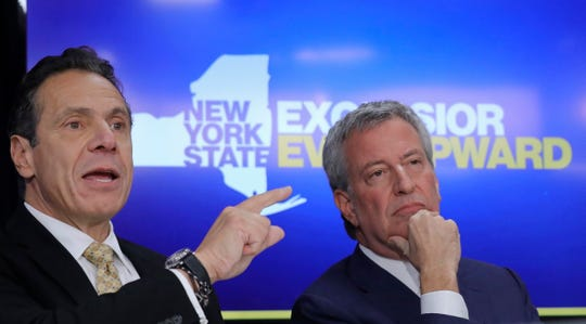 New York City Mayor Bill de Blasio, right, listens as New York Gov. Andrew Cuomo speaks during a news conference Tuesday Nov. 13, 2018, in New York. Amazon said it will split its much-anticipated second headquarters between New York and northern Virginia. Its New York location will be in the Long Island City neighborhood of Queens.