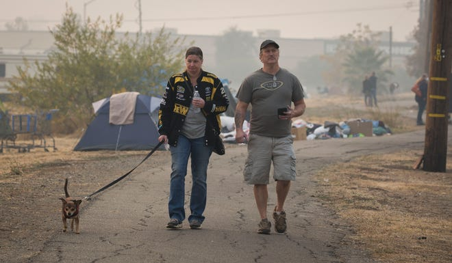 People who have taken refuge in a make-shift compound in the Walmart parking lot in Chico, CA, try to maintain some normalcy in the camp November 14, 2018. Many of the people camping there do not know if they have a home to return to or not.