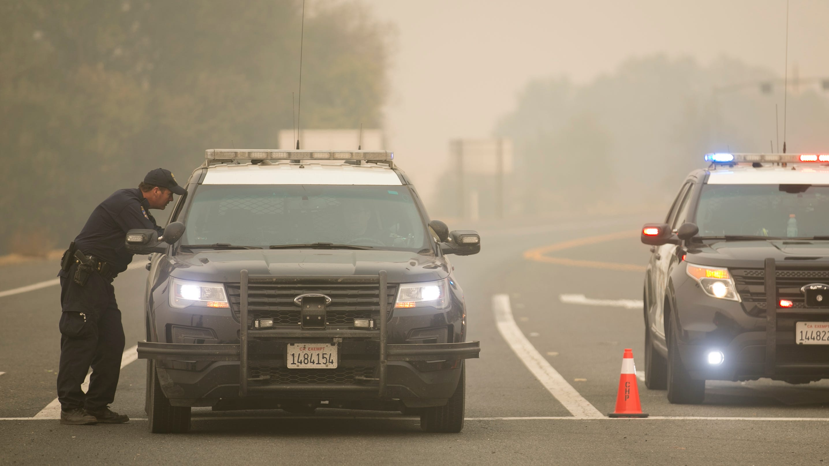 Police vehicles block Highway 70 after an officer involved shooting resulted in the death of a suspect in Butte Valley, California on Nov. 15, 2018. The shooting occurred after a high-speed chase and ended within the evacuation perimeter of the Camp Fire.