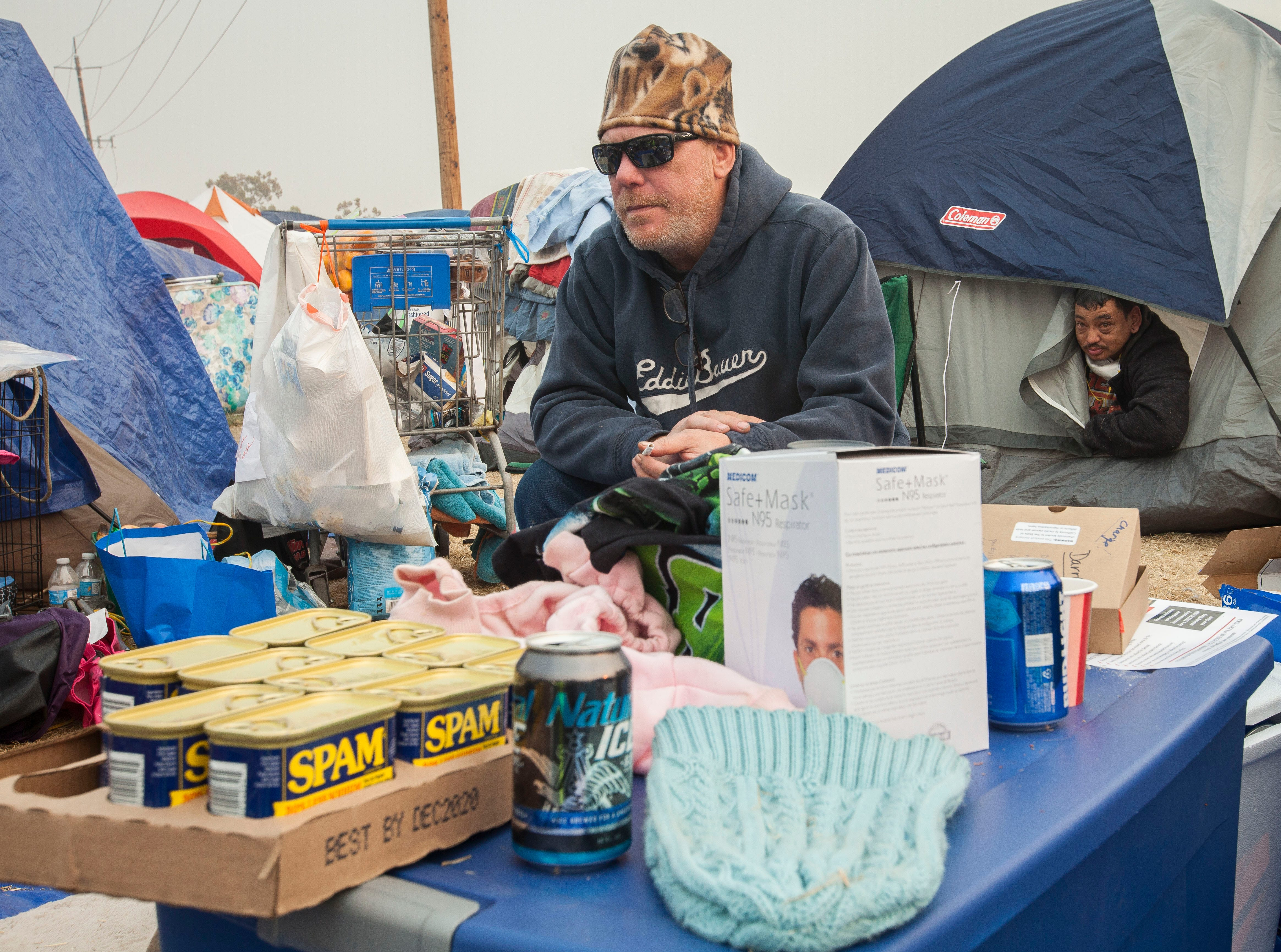 Daryl Merritt, 55, of Paradise, sits in his tent compound in a field next to the Walmart in Chico, CA, Wednesday, November 14, 2018. Merritt has no idea if his home survived the Camp Fire but is making the best of things with new friends and neighbors.