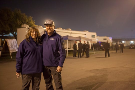 Teresa and James Lamb, owners of All American Emergency Services, work into the evening at the Butte County Fairgrounds making sure all of their tents, trailers and other services are working smoothly at the emergency operations center set up there for the Camp Fire.