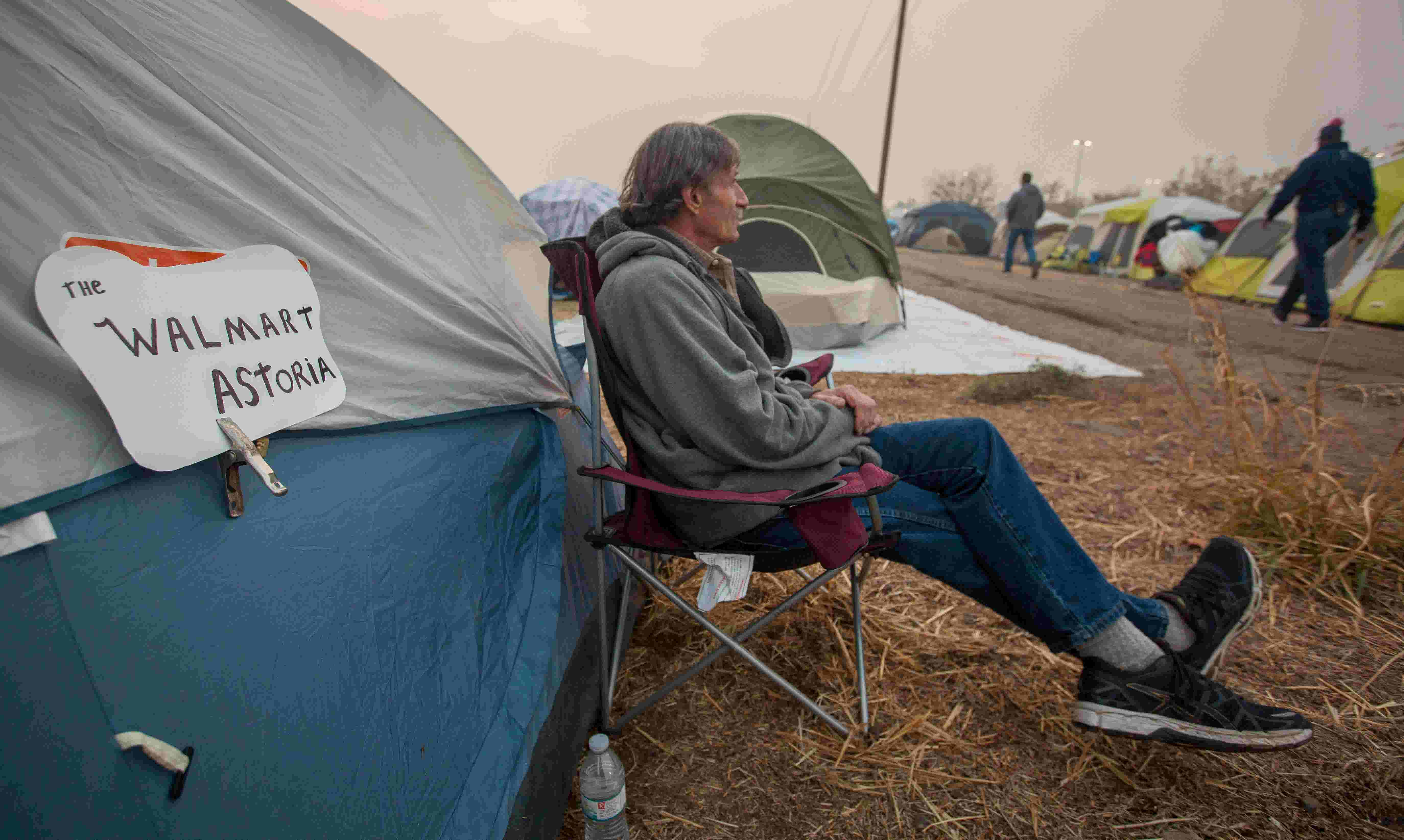WATCH: Camp Fire evacuees at a tent city in a Walmart parking lot