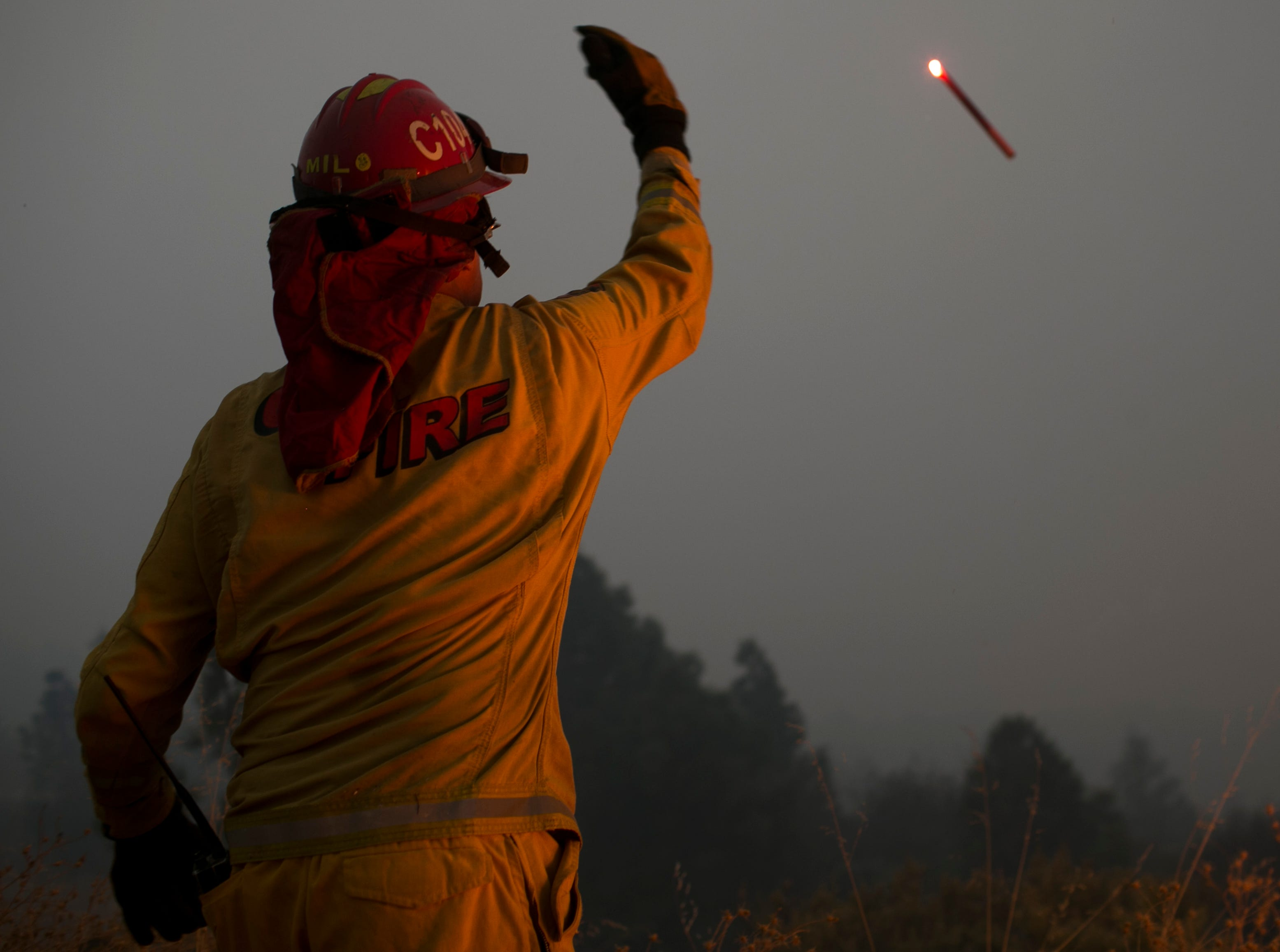Firefighters hold a line in the Camp Fire with a control burn Near Bloomer Hill in Butte County in California on Nov. 14, 2018.