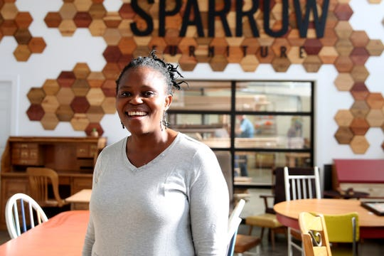 Blandine Kangah, a refugee from the Ivory Coast, at Sparrow Furniture in Salem on Thursday, Nov. 8, 2018. Sparrow Furniture specifically hires refugees resettled in Salem and provides them with career experience and language skills.