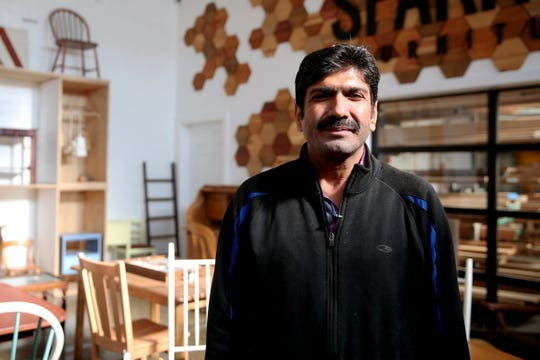 Muhammad Iqbal, a refugee from Pakistan, at Sparrow Furniture in Salem on Thursday, Nov. 8, 2018. Sparrow Furniture specifically hires refugees resettled in Salem and provides them with career experience and language skills.