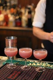 Jason Wenger places finishing touches on a round of competition cocktails at Brutal Bar on Nov. 5, 2019.