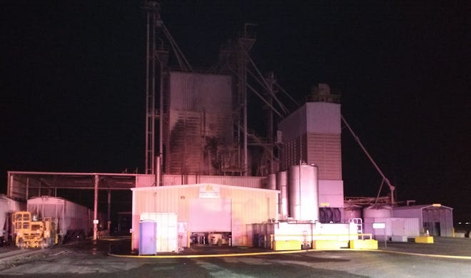 Crews fought a four-alarm fire Wednesday night at a commercial feed mill near Donald and Aurora.