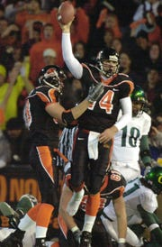 Oregon State quarterback Derek Anderson passed for 351 yards and four touchdowns in his final game at Reser Stadium, a 50-21 victory over Oregon on Nov. 20, 2004.