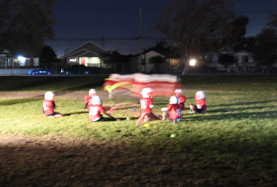 The Salinas Cardinals' team practices in the back fields of Lincoln Elementary school and will play a southern California team this weekend in the Pop Warner playoffs.