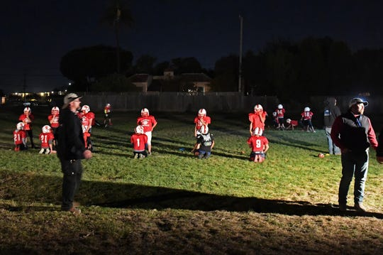 Due to Daylight Savings Time, practices for the Salinas Cardinals require lights hooked up to a car battery in order to see what they need to do.