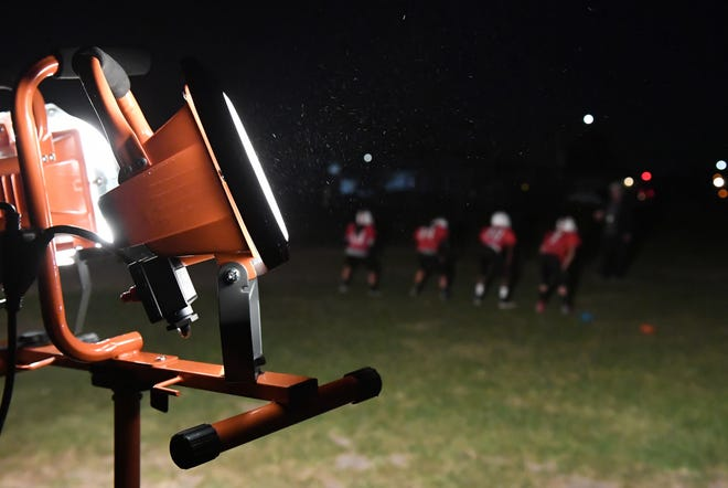 1000-watt stand lights helps the Salinas Cardinal players see the field during weekday practices.