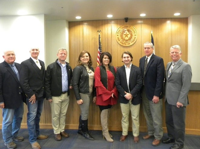 Members of the Tom Green County Commissioners Court join representatives of the San Angelo Chamber of Commerce, Grape Creek ISD and E.ON Energy to mark a tax abatement agreement  that will clear the way for a new solar farm near San Angelo.