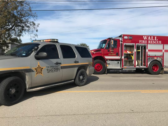 A Wall volunteer fire department truck and a Tom Green County Sheriff's car blocks off traffic in the 2700 block of Paint Rock Road for a structure fire around noon Thursday, Nov. 15.