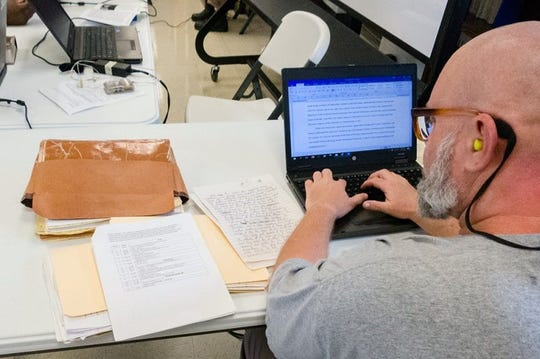 An inmate at Nash Correctional Institution works on material for a theology class in Nashville, N.C.