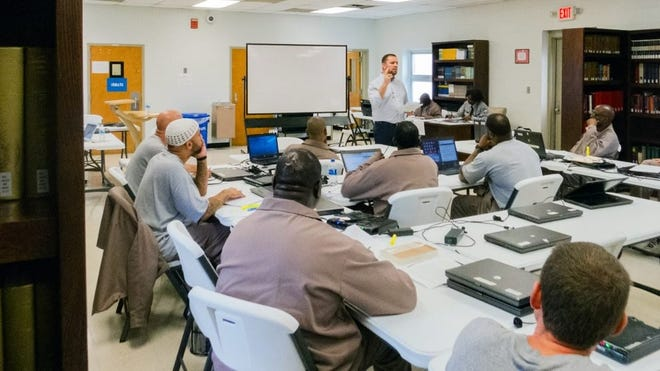 Jamie Dew, dean of the college at Southeastern Baptist Theological Seminary, teaches a theology class to inmates at Nash Correctional Institution in Nashville, N.C.