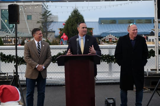 From left: Rep. Steve Smyk (R), Sen. Ernie Lopez (R-Lewes) and House Speaker Pete Schwartzkopf (D-Rehoboth) stand in support of Winter Wonderfest at the Cape May-Lewes Ferry Terminal on Nov. 14.