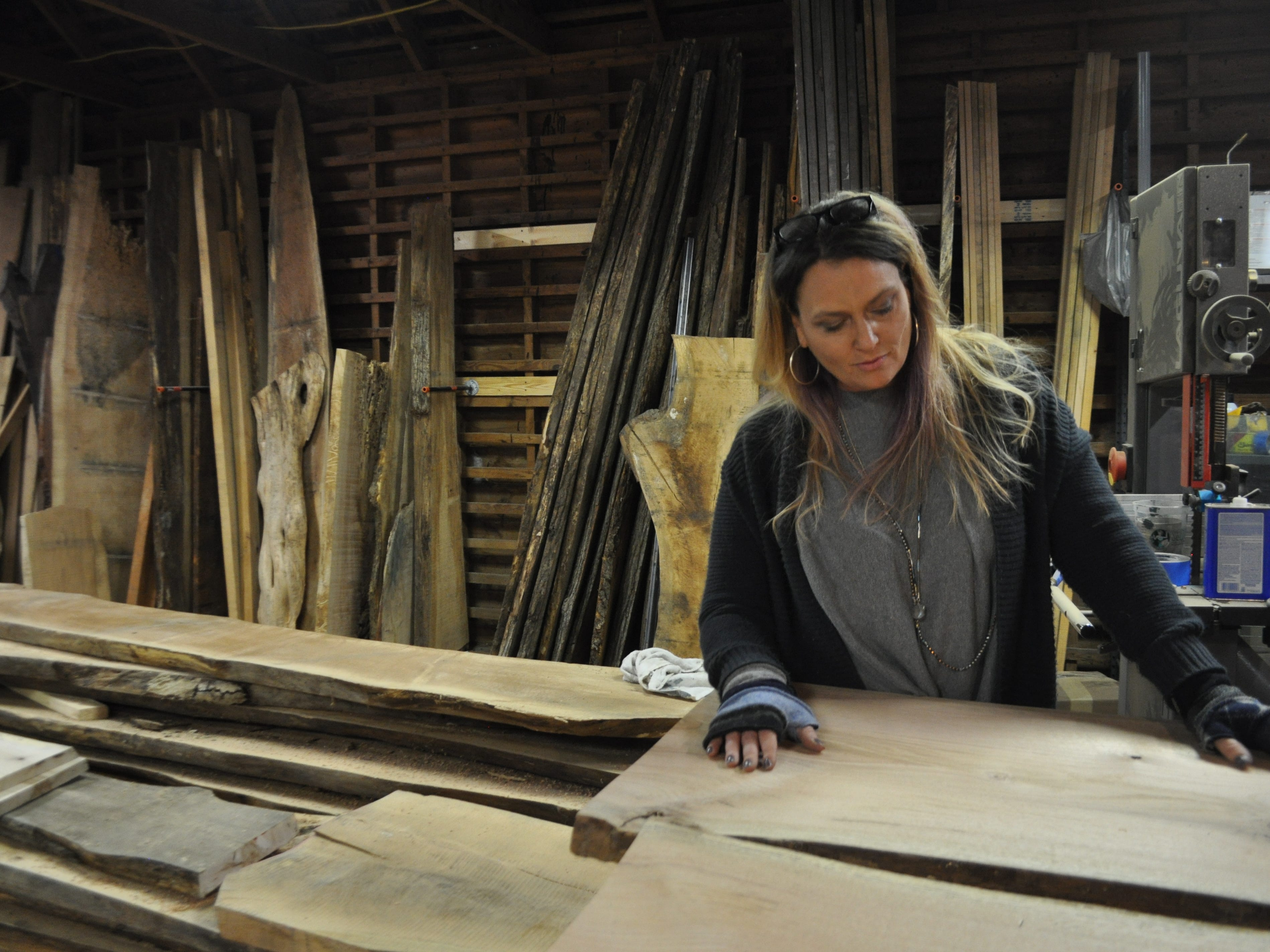 Attics of My Life store owner Ashley Abell stands in her woodworking shop at her store's new Selbyville location on Nov. 14, 2018.