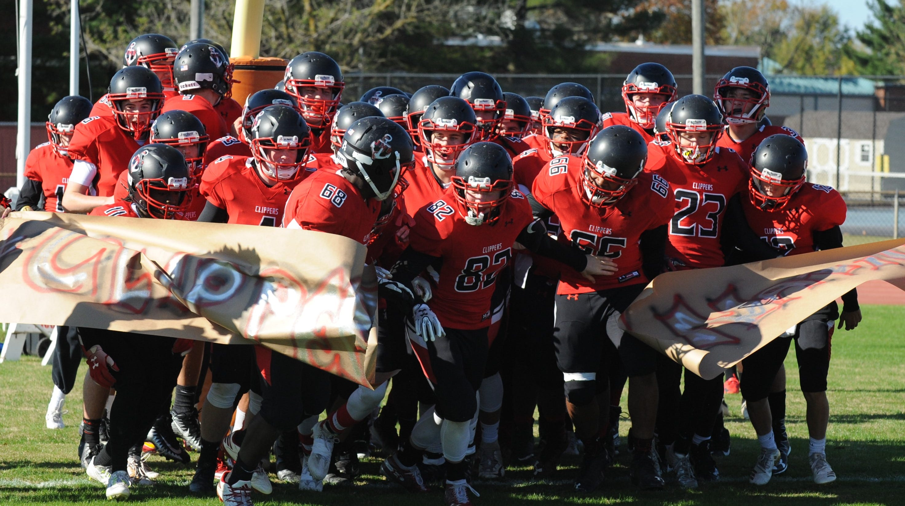 The James M. Bennett football team runs onto the field for its playoff game against Long Reach on Saturday, Nov. 10, 2018.