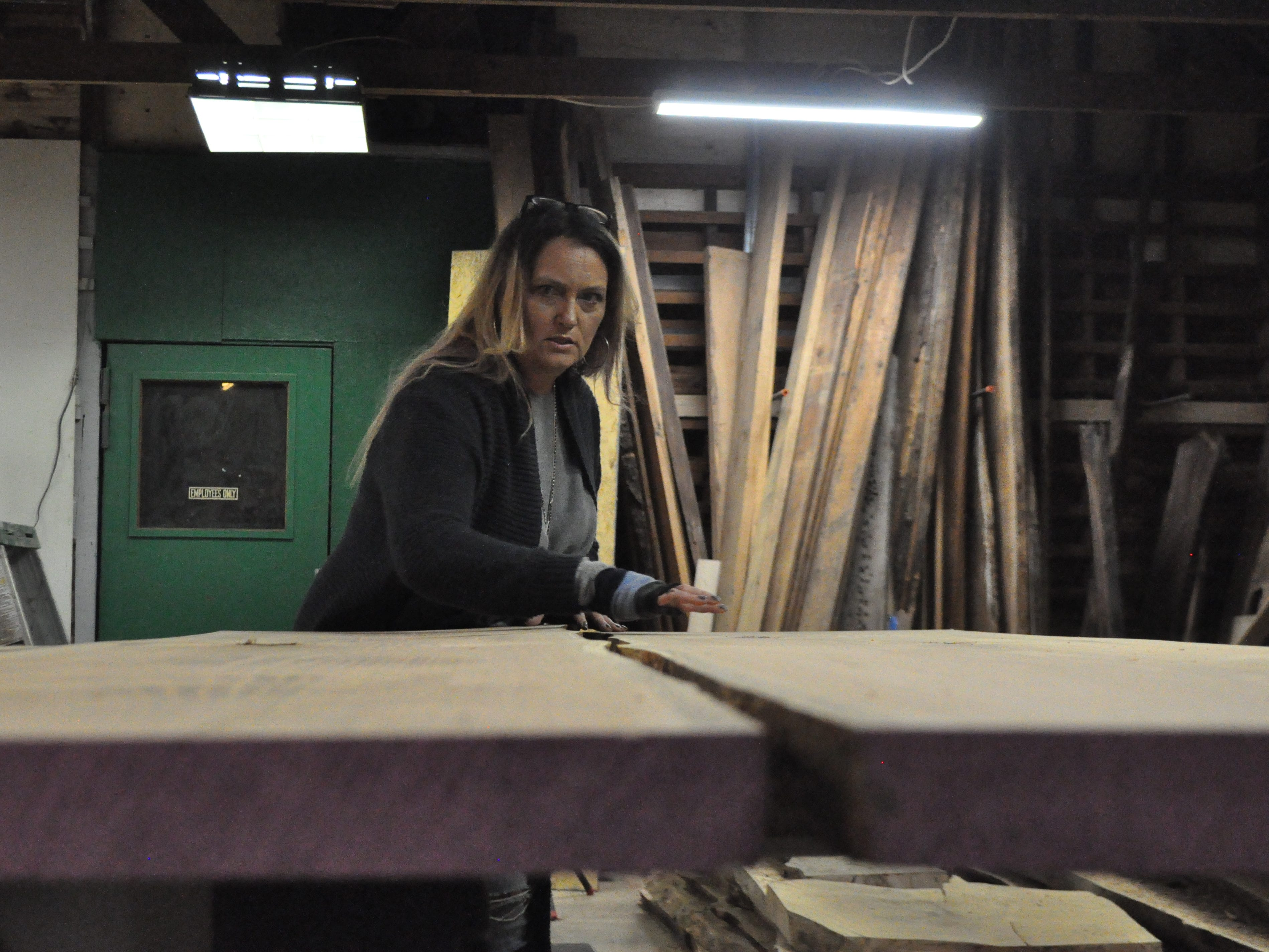 Attics of My Life store owner Ashley Abell shows a table in the making at her woodworking shop at her store's new Selbyville location on Nov. 14, 2018.
