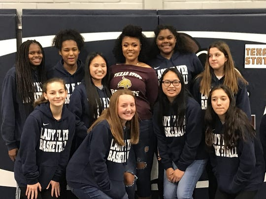 The 2018-19 Loyola Flyers were in support of Chelsea Johnson's signing.