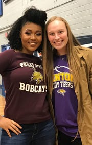 Loyola's Chelsea Johnson and Benton's Emily Ward share a moment at Johnson's signing event Wednesday evening.