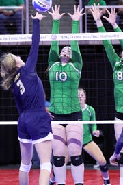Madison Wetz of Miller stretches to block a spike by Tori Altstiel of Rapid City Christian during Thursday's state tournament action in Sioux Falls.