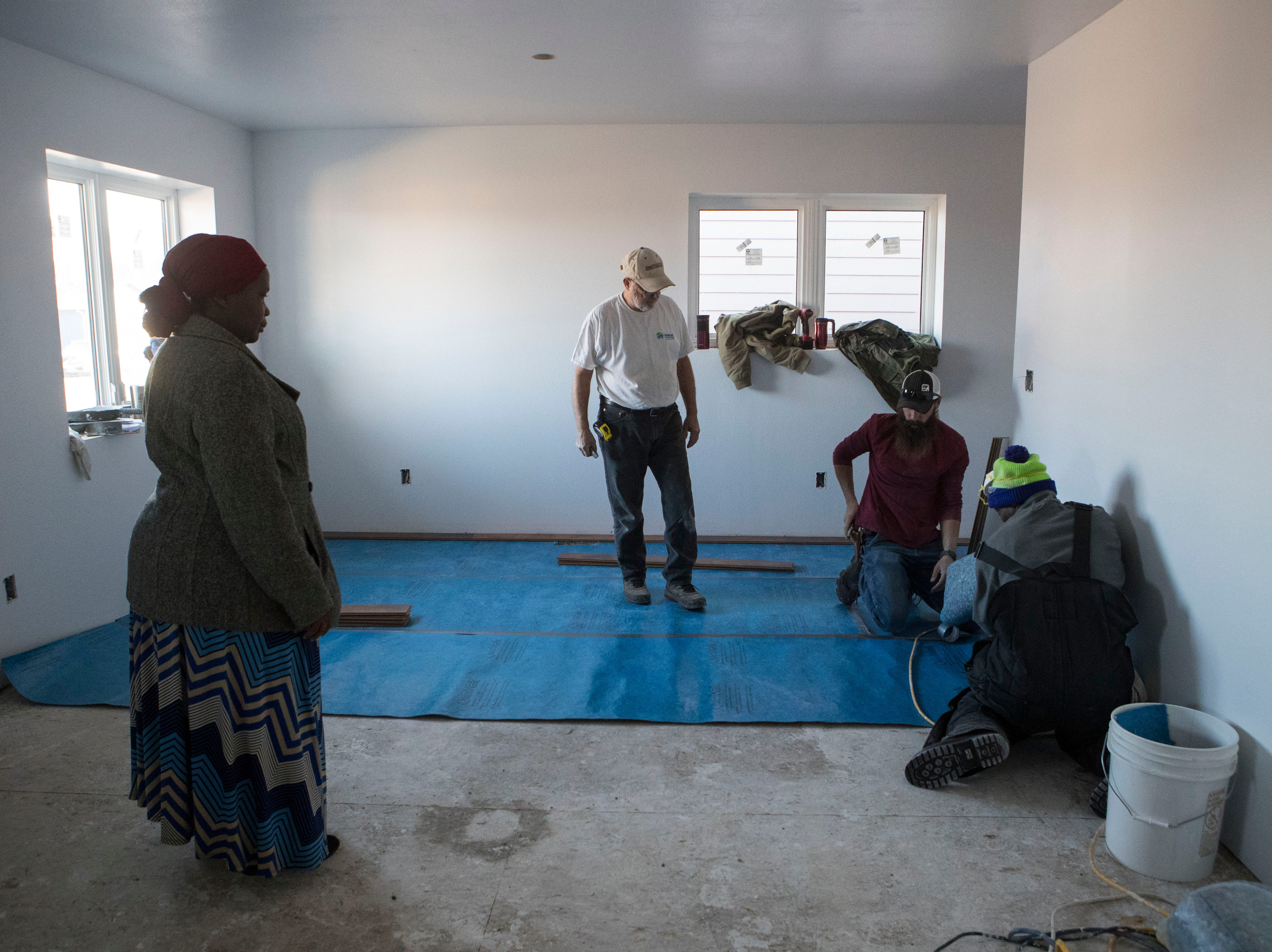 Volunteers for Habitat for Humanity build a house in Sioux Falls, S.D., Thursday, Nov. 15, 2018.