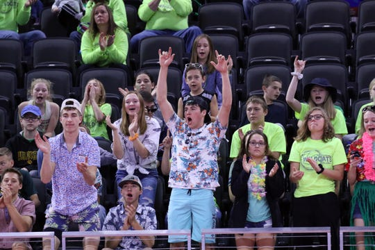 Northwestern fans cheer another point for their team during Thursday afternoon's match against Kimball-White Lake in Sioux Falls.