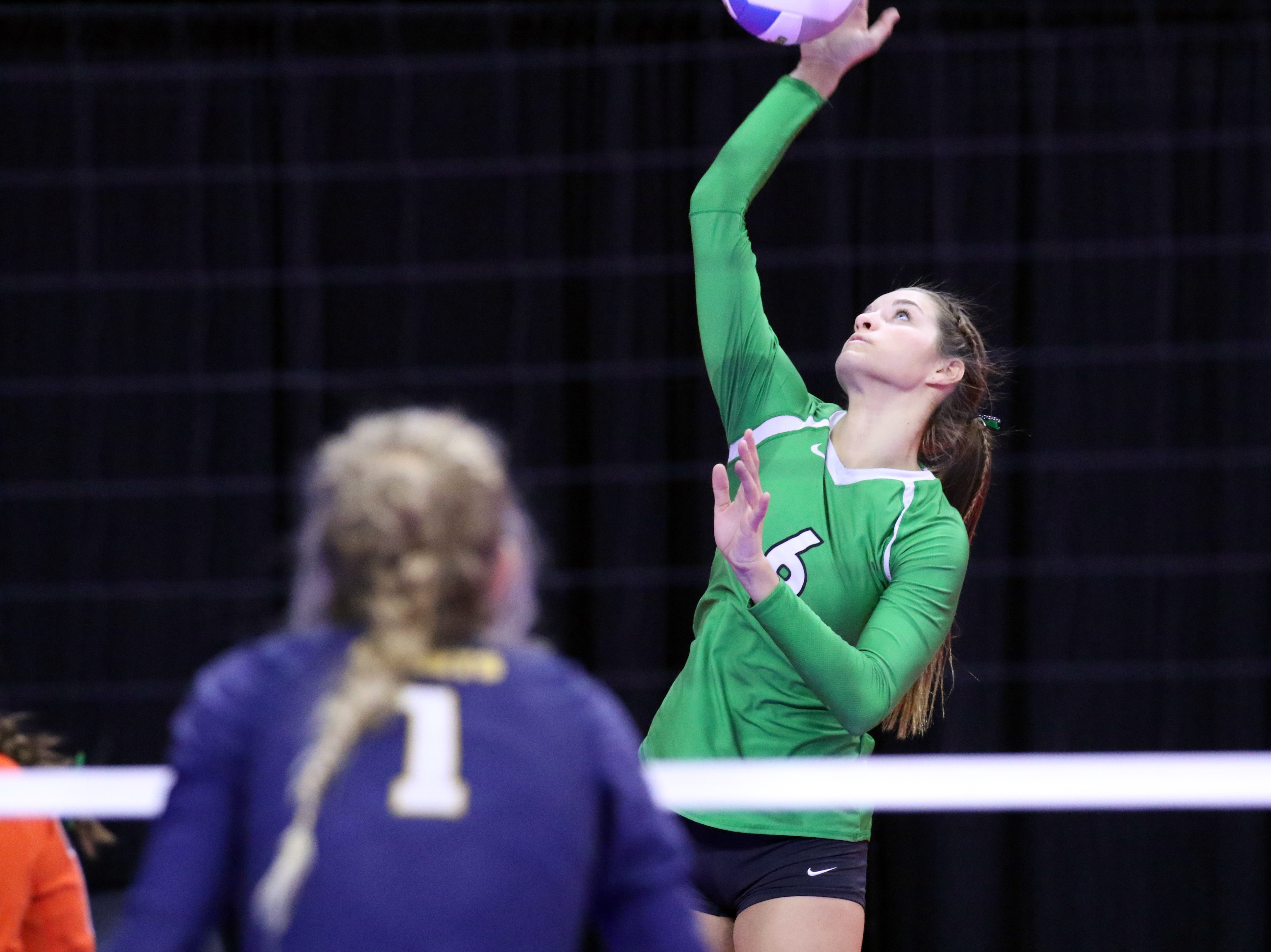 Kayde Fernholz of Miller serves the ball as Riley Freeland of Rapid City Christian looks on during Thursday afternoon's match in Sioux Falls.