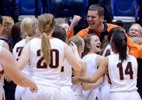 The Washington Warriors celebrate their 58-51 win over Mitchell Saturday at the Class AA girls high school basketball championship at Frost Arena in Brookings, March 15, 2014.