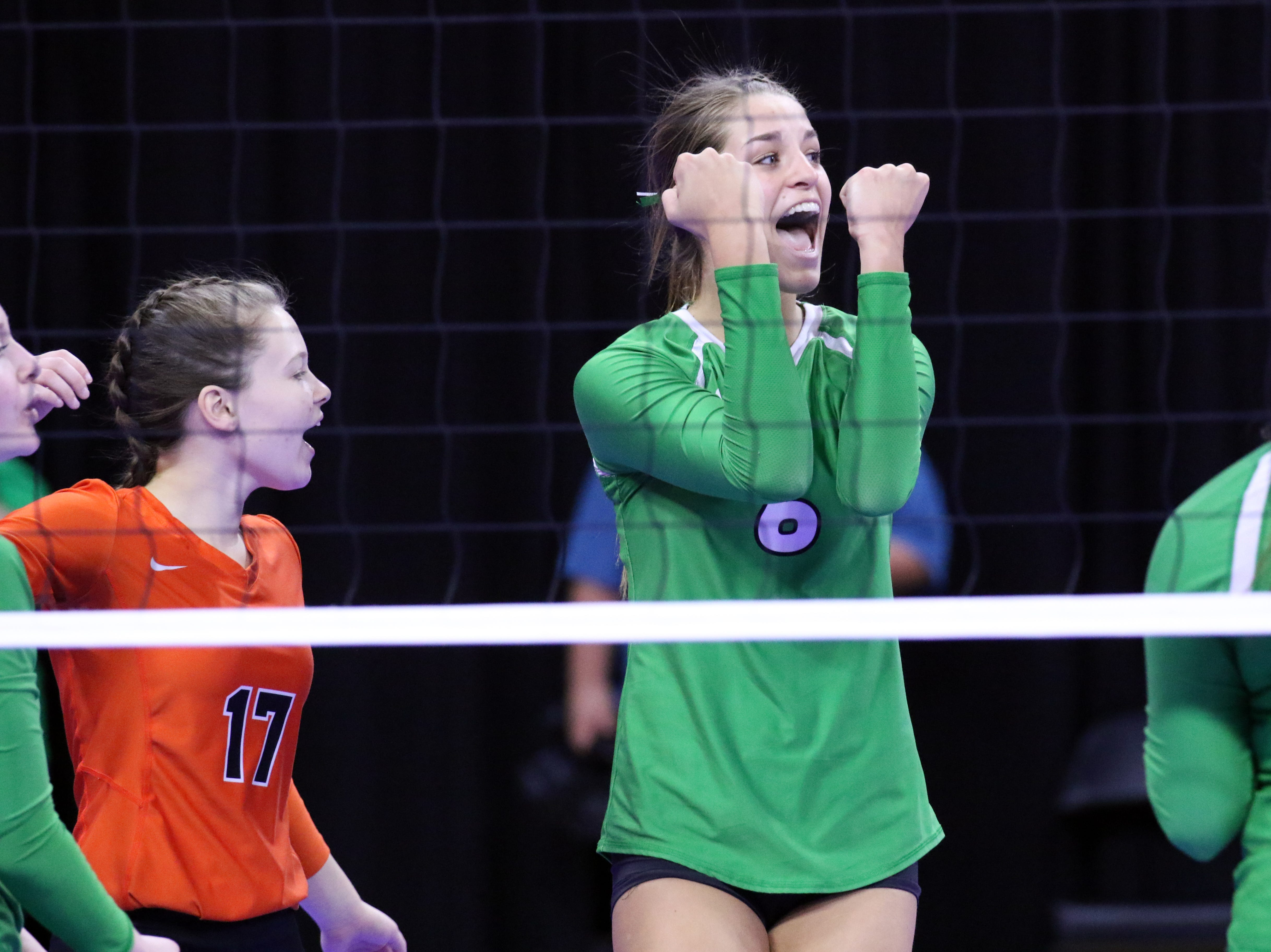 Kadye Fernholz of Miller celebrates a point with her teammates during Thursday afternoon's match against Rapid City Christian in Sioux Falls.