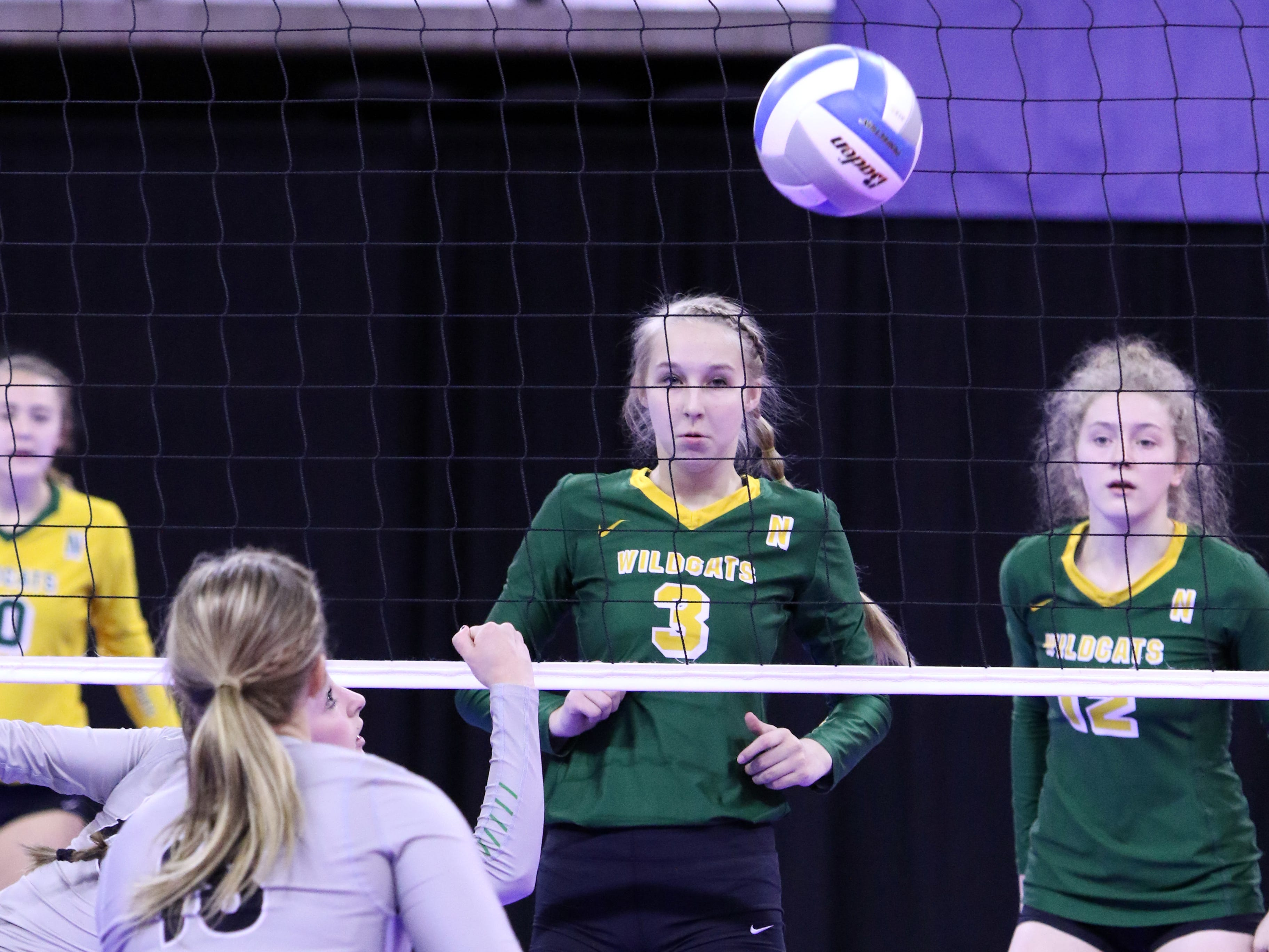 Caitlyn Fischbach of Northwestern reacts to a volley near the net by several Kimball-White Lake players during Thursday's state tournament in Sioux Falls.
