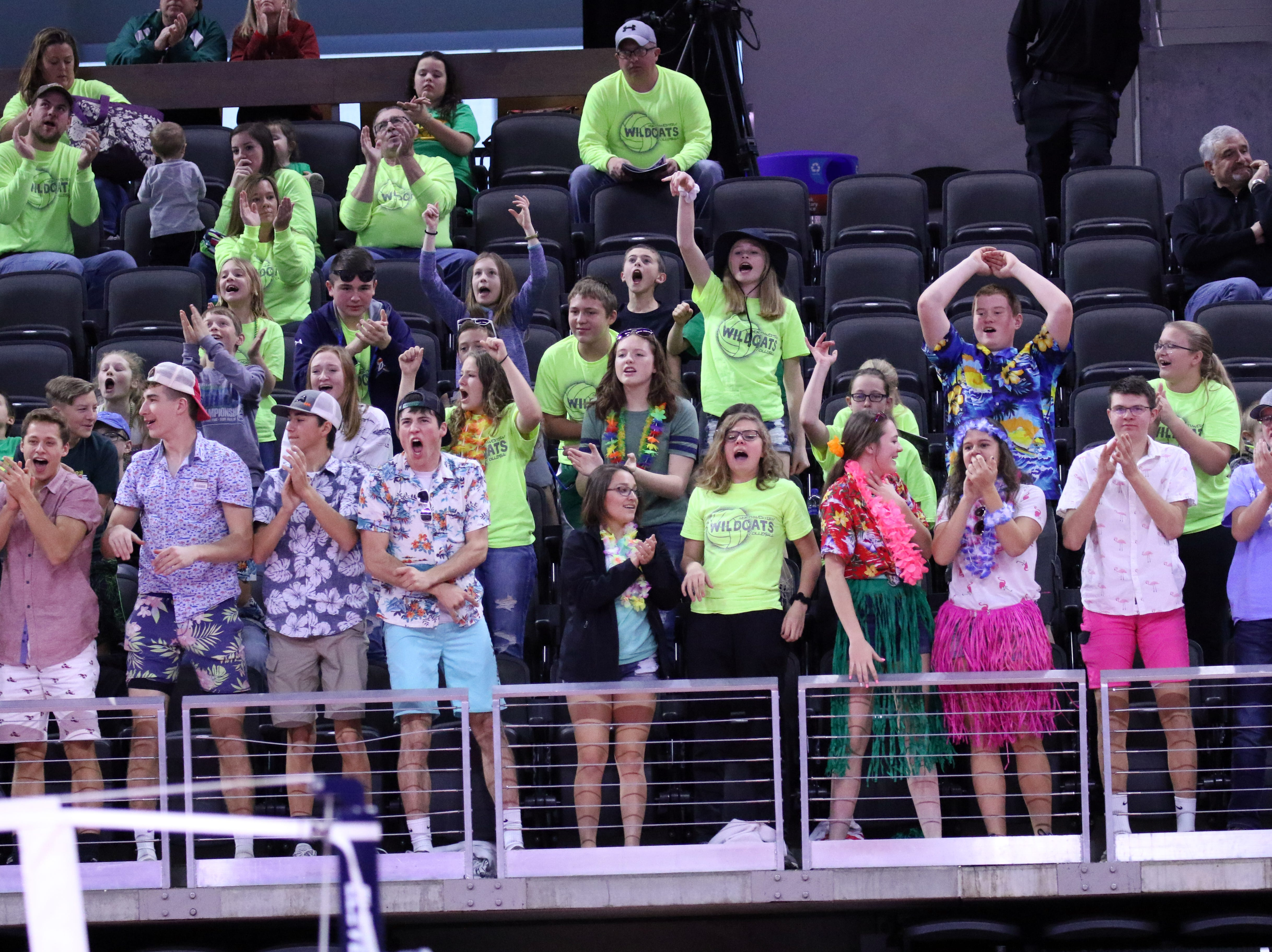 The Northwestern student section cheers for their team during Thursday afternoon's match against Kimball-White Lake in Sioux Falls.