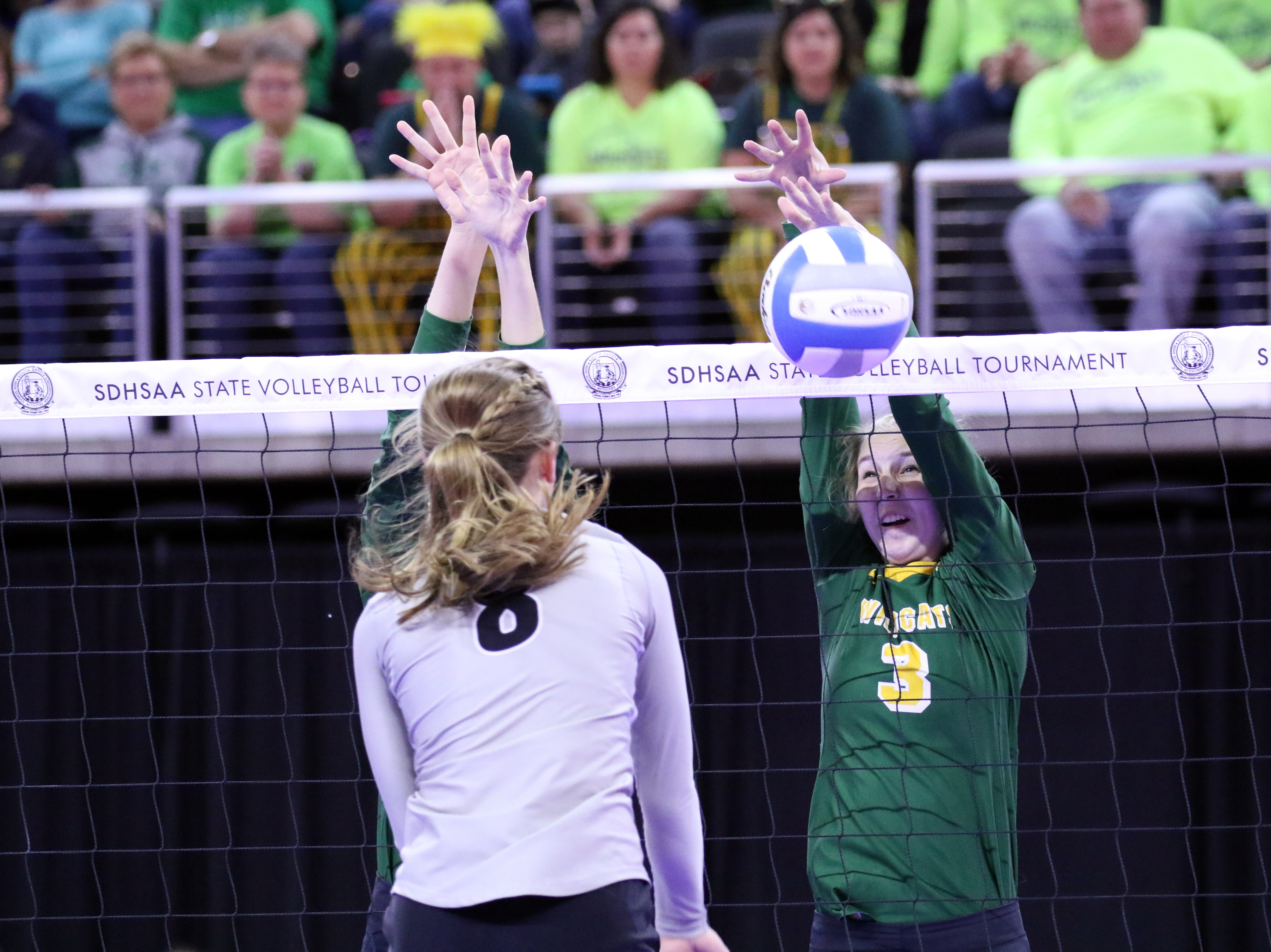 Caitlyn Fishbach of Northwestern blocks a spike by Kennedy Leiferman of Kimball-White Lake during Thursday's state tournament in Sioux Falls.