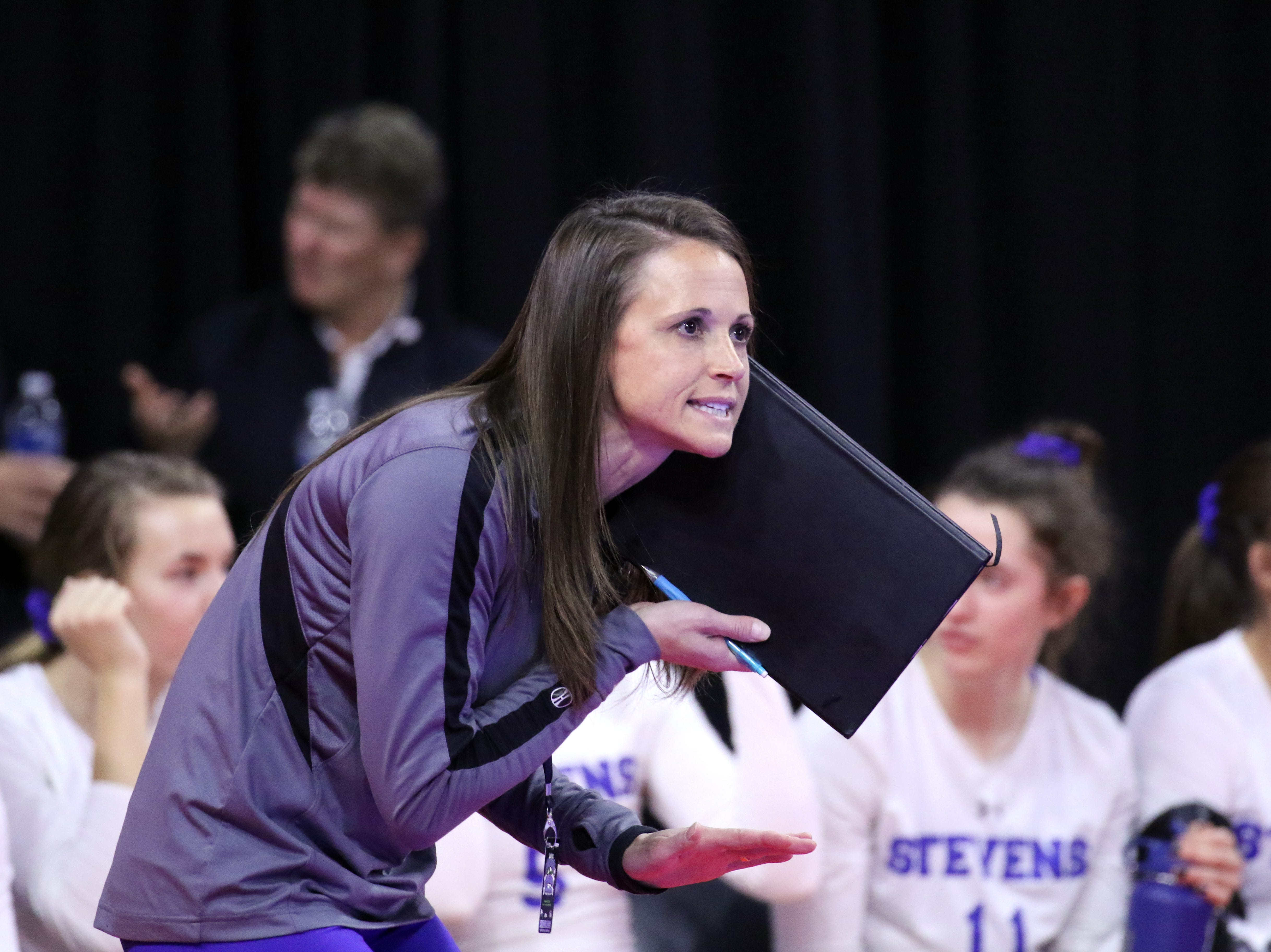 Rapid City Stevens head coach Kylie Voorhees gives instructions to her players during Thursday's opening match with Brookings in Sioux Falls.